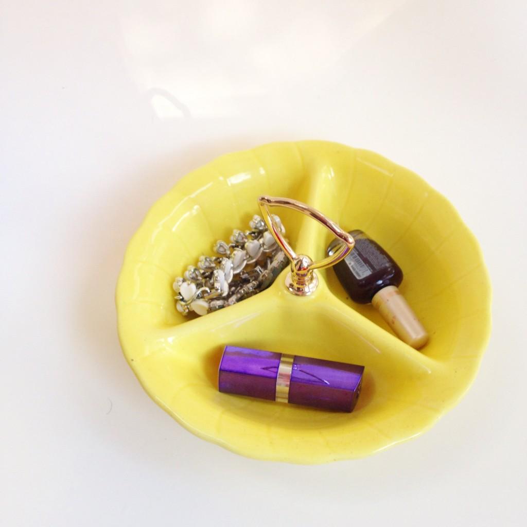 yellow jewelry dish