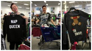"""A collage of three pictures: the one on the left is of a woman holding a black sweater with the words """"nap queen"""" written in white, the center image is the same woman standing behind a blue shopping cart filled with items including coffee mugs and baby cloths, and the picture on the right is of the same woman holding a sweater with a gingerbread man on it that says """"oh snap"""""""