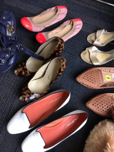 A picture of a few different pairs of shoes: leopard print heels, white shoes with pink soles, pink flats, silver open toed heels, and tan shoes