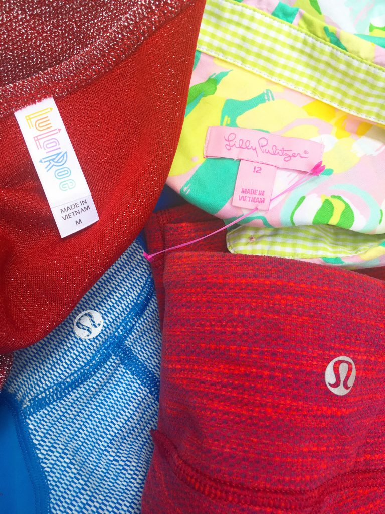 A close up picture of Lululemon clothing logos and a Lilly Pulitzer tag