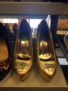 A picture of gold heels at the Waldorf Goodwill of Greater Washington retail location