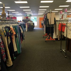 A picture of the interior of the Waldorf Goodwill of Greater Washington location with racks of clothing throughout the shot