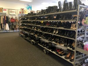 A picture of a large rack of shoes at the Waldorf Goodwill of Greater Washington retail location