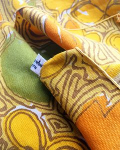 A close up of the yellow patterned napkins