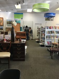 The furniture and books and media section of the Alexandria Goodwill of Greater Washington retail store