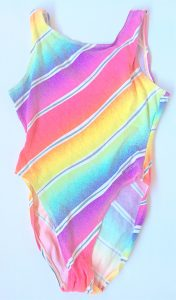 A picture of a pastel rainbow colored women's one piece Reebok bathing suit