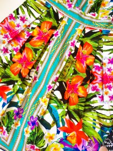 A close up of the bright, tropical floral pattern on the Maggy London dress