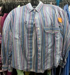A picture of a vintage, 1990's, button up top. It has a few shades of blue and pink and has vertical stripes in different patterns