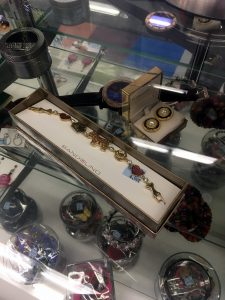A picture of the jewelry case at the Centreville VA Goodwill retail store with various necklaces, earrings, and bracelets in it
