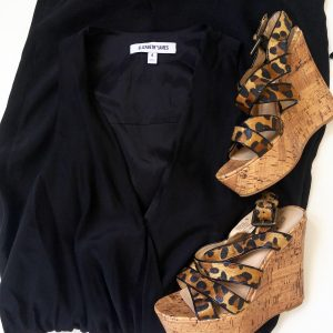 A close up of a picture of two items, black, silk, tuxedo-style dress by Elizabeth & James and animal print wedges by Tallulah Blu
