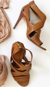 A picture of the strappy, tan, authentic Tory Burch heels in a size 7.5