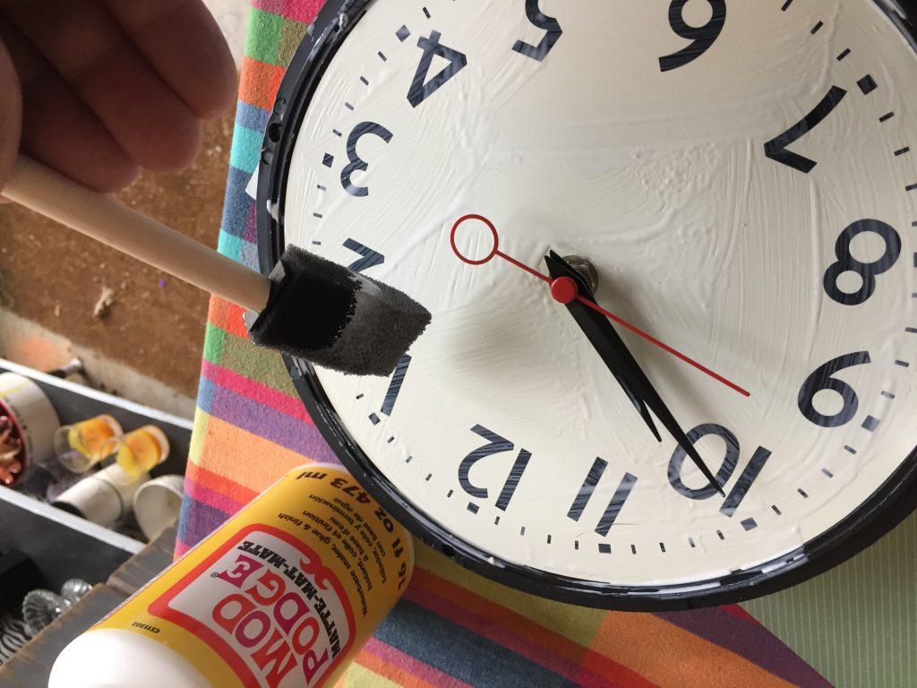 Goodwill clocks modge podge face