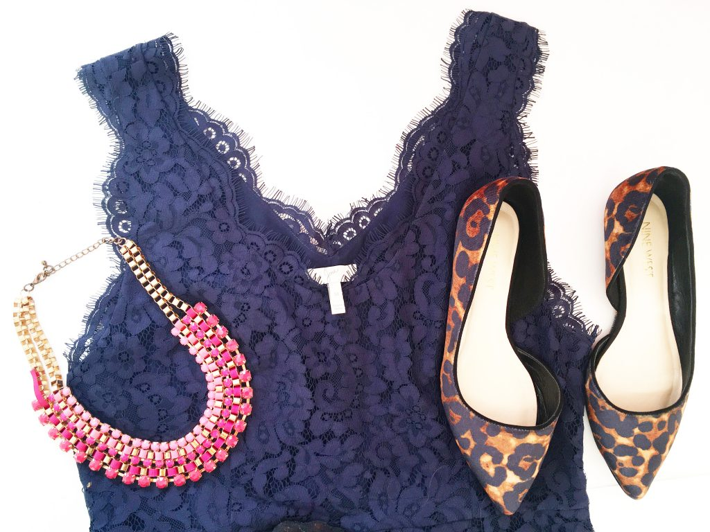 Blue lace dress with pink necklace, and animal print shoes