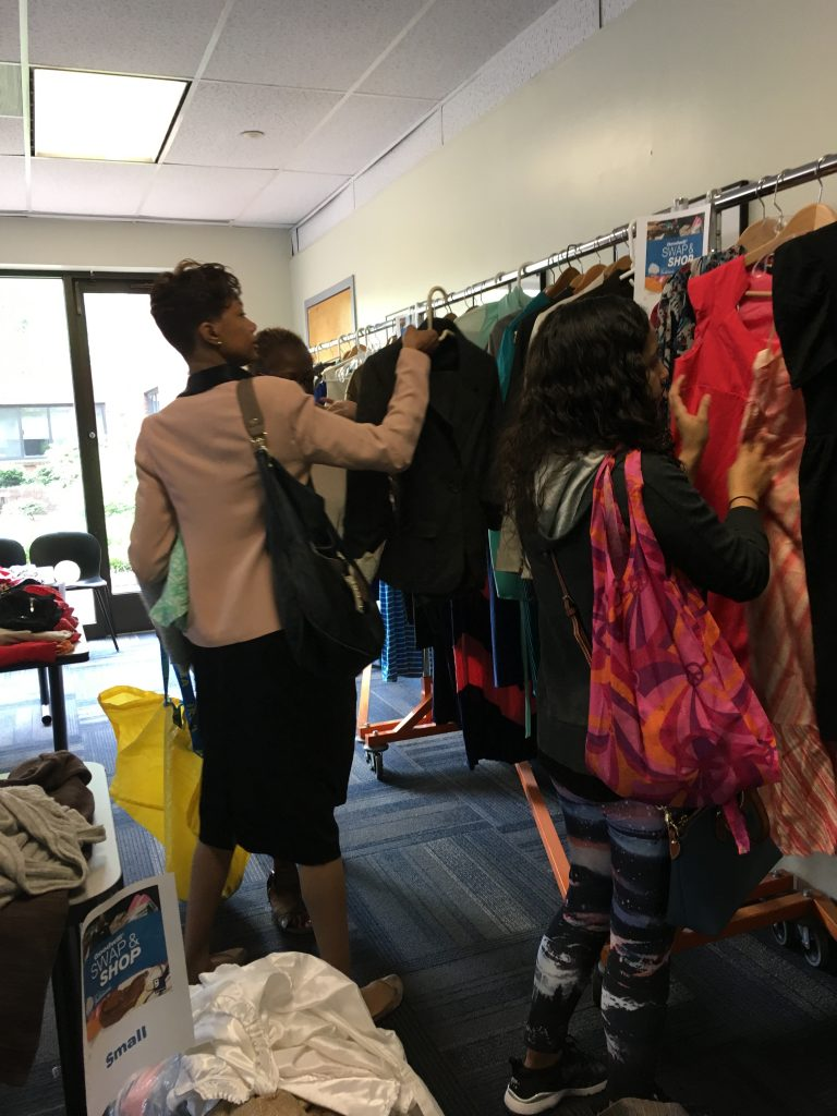 people shopping at clothing swap