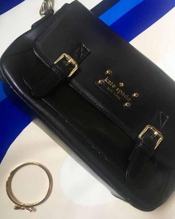 black kate spade crossbody bag and gold kate spade bow bracelet