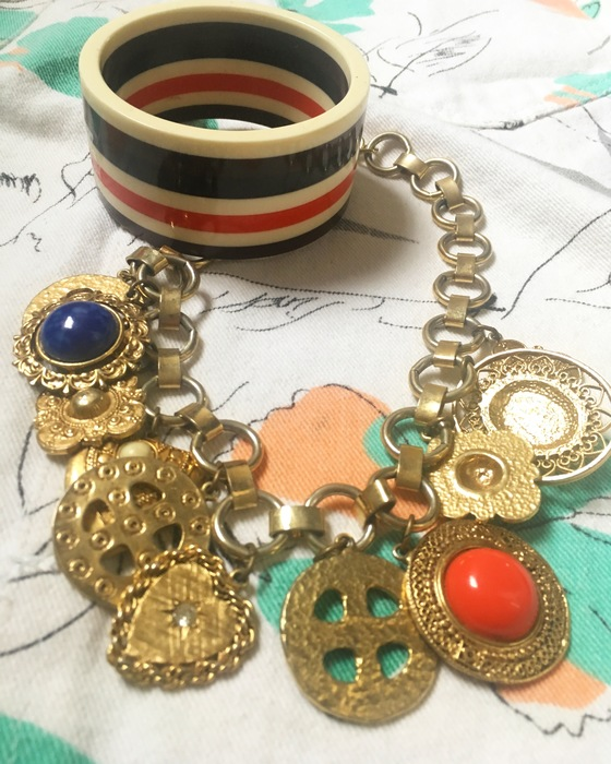 vintage gold necklace and red, white and beige bangle