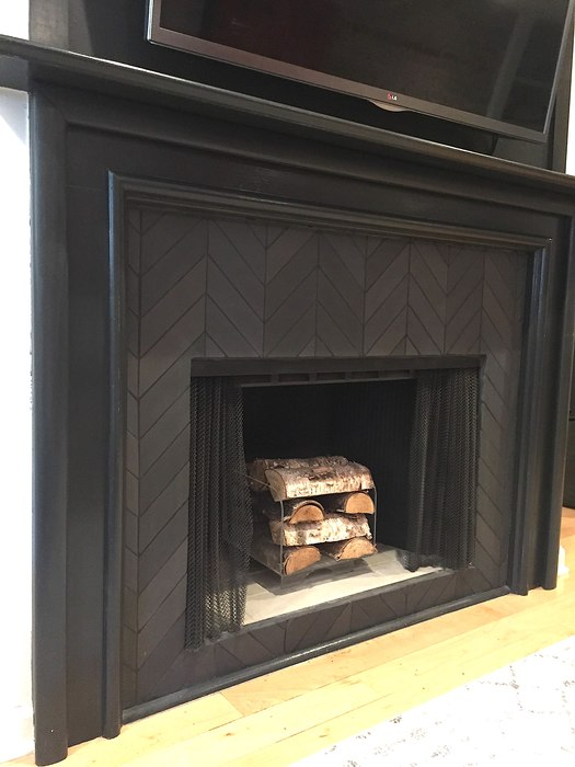 Ariel uses an acrylic box to store wood in her fireplace