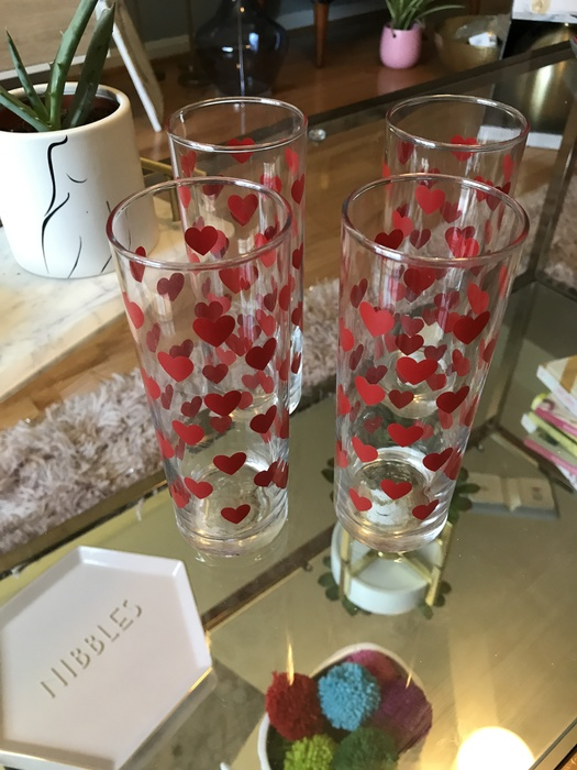 A set of four heart glasses purchased at Goodwill