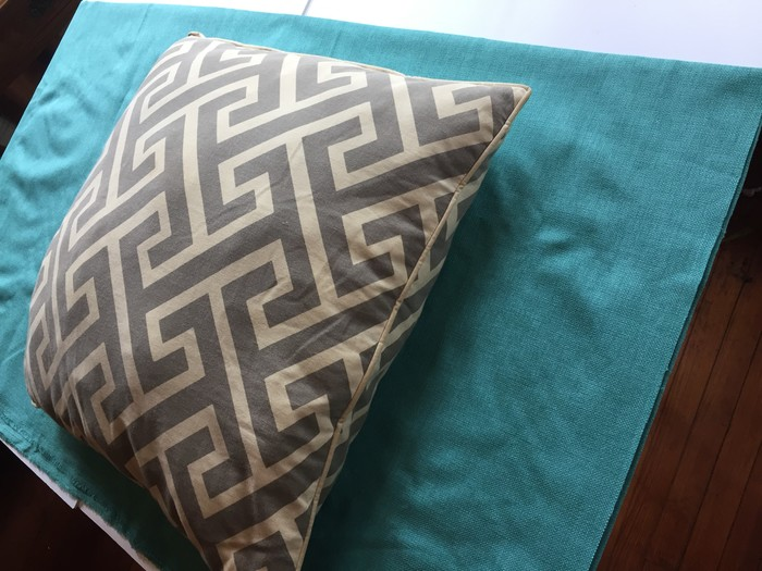 Tim sets pillow atop outdoor-friendly fabric