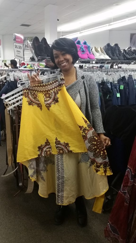 meetup shopper poses with yellow high-low skirt