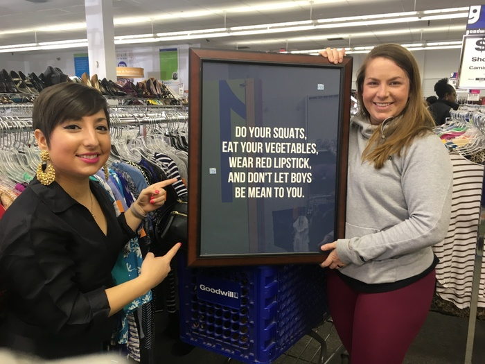 Carolyn and Meetup shopper pose with framed quote