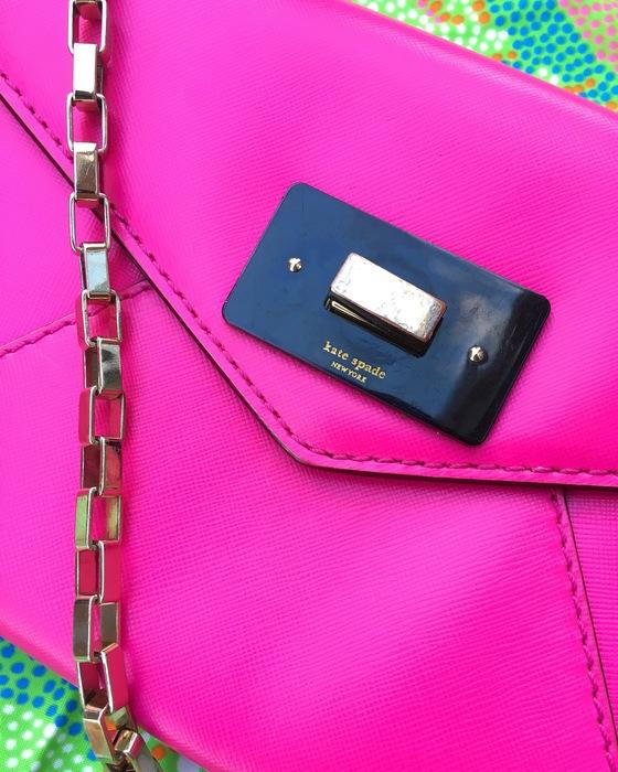 hot pink Kate Spade cross-body bag found at South Dakota Goodwill