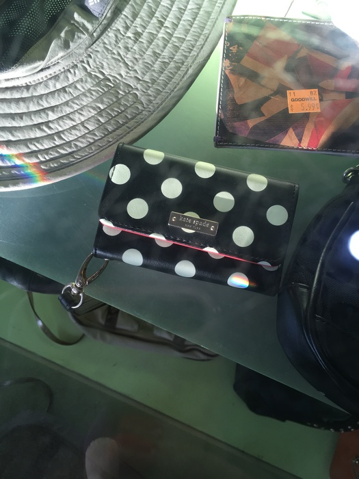 Kate Spade wallet in Goodwill display case