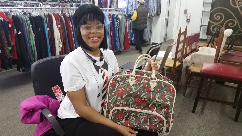 Meetup shopper poses with Guess handbag found at South Dakota Goodwill
