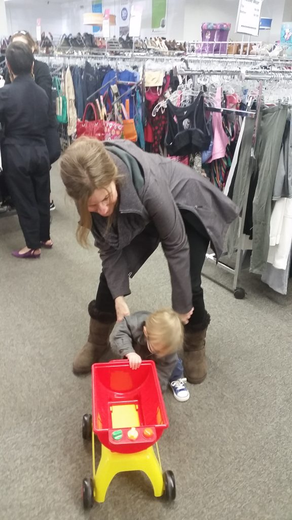 Meetup shopper and child play with toy found at South Dakota Goodwill