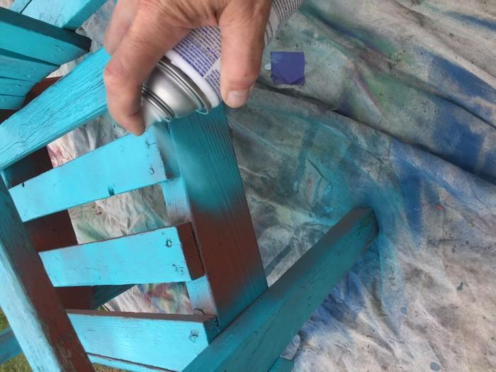 Tim sprays patio chair blue