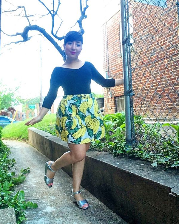 Carolyn strikes a pose in a banana print mini skirt found at the Columbia Pike Goodwill