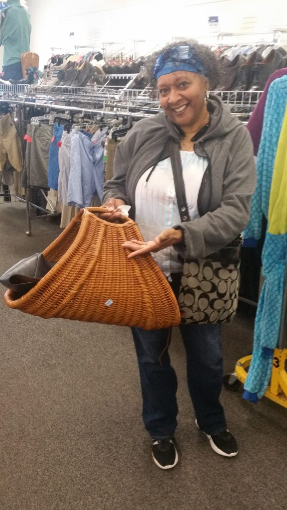 Meetup shopper shows off a wicker basket found at the Columbia Pike Goodwill