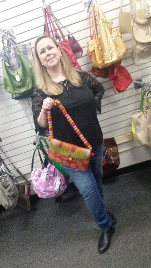 Meetup shopper poses with handmade knit purse found at Columbia Pike Goodwill