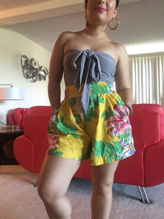 Carolyn models her beach outfit featuring vintage floral shorts from Goodwill.