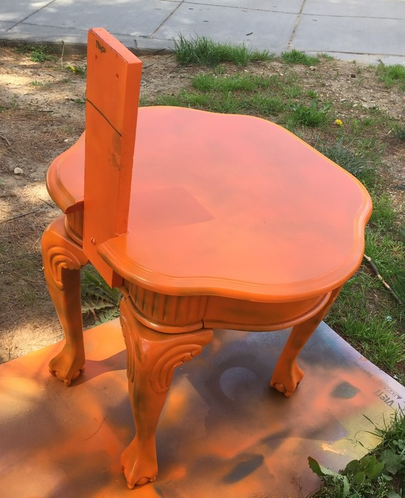 Tim's boutique-style chair painted orange