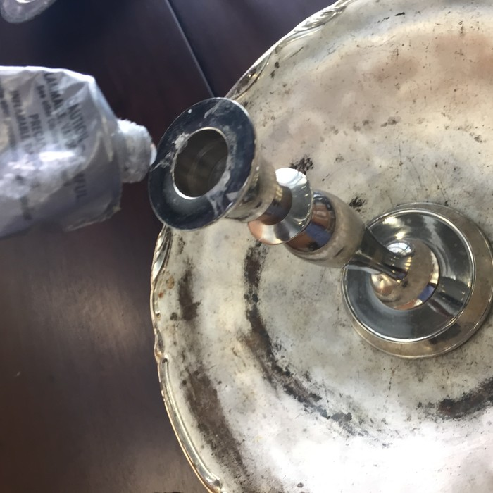 Tim glues Goop to top of candlestick holder