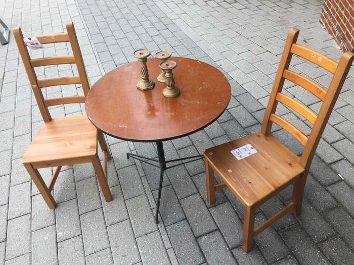 Tim's candle sticks, table, and chairs found at Goodwill store