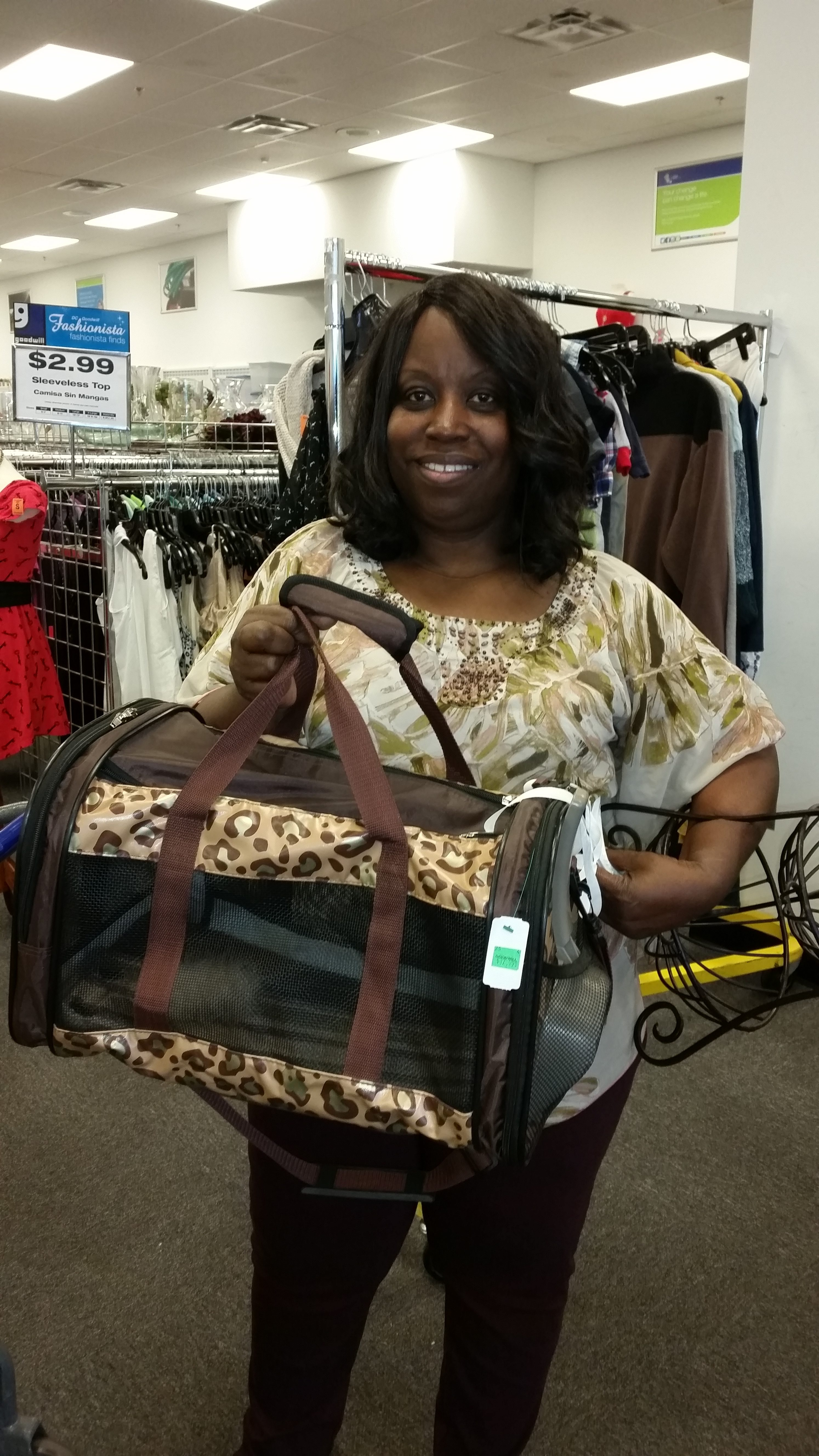 Meetup shopper poses with a pet carrier found at Goodwill