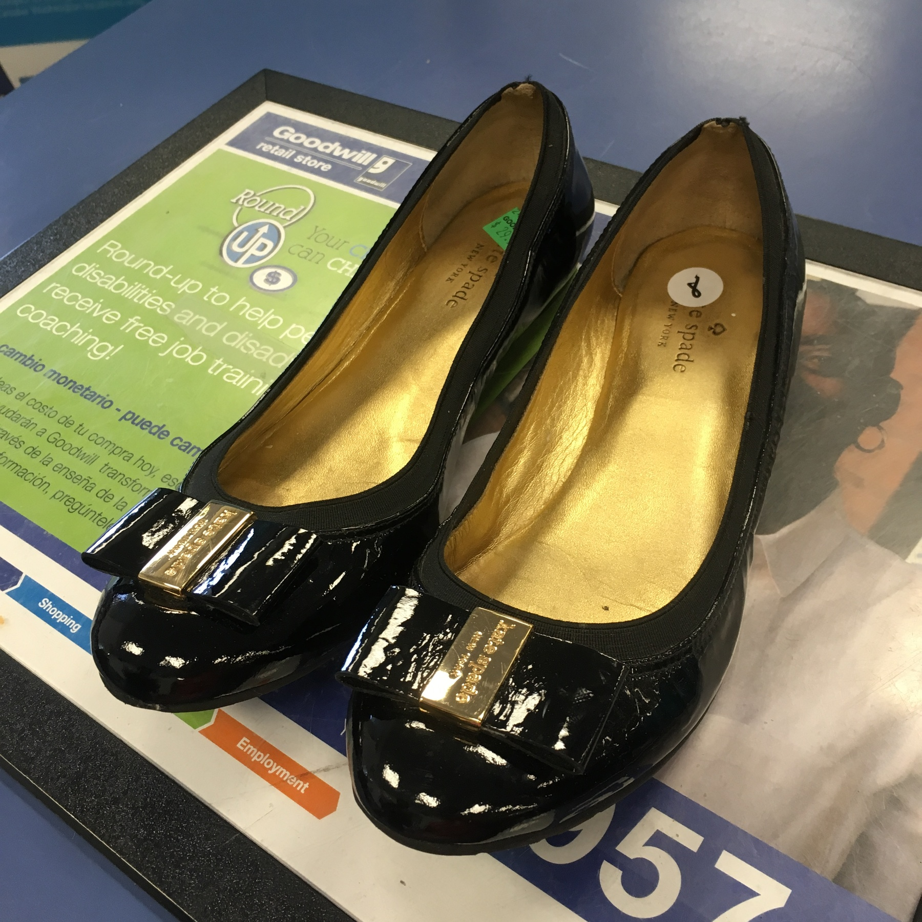 black Kate Spade flats found at Kings Highway Goodwill