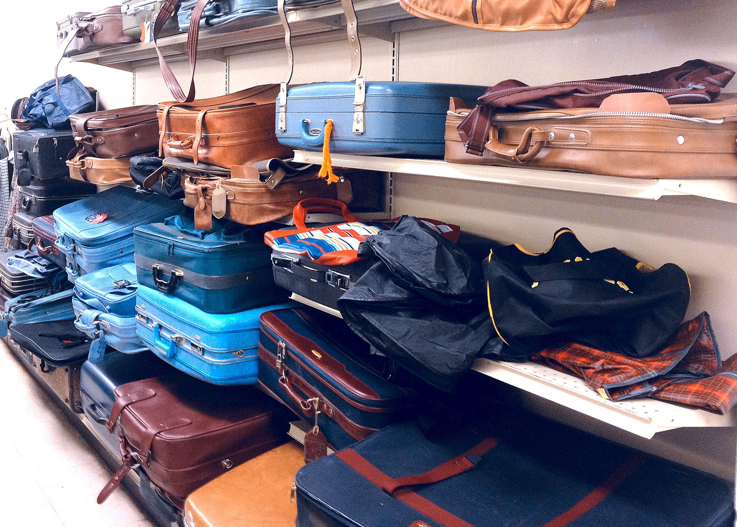 Luggage and bags at Goodwill store