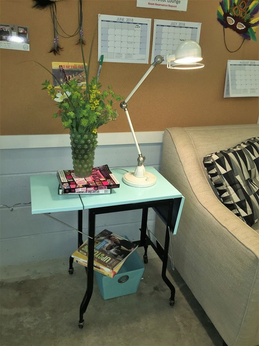Tim's upcycled typewriter table used as an end table
