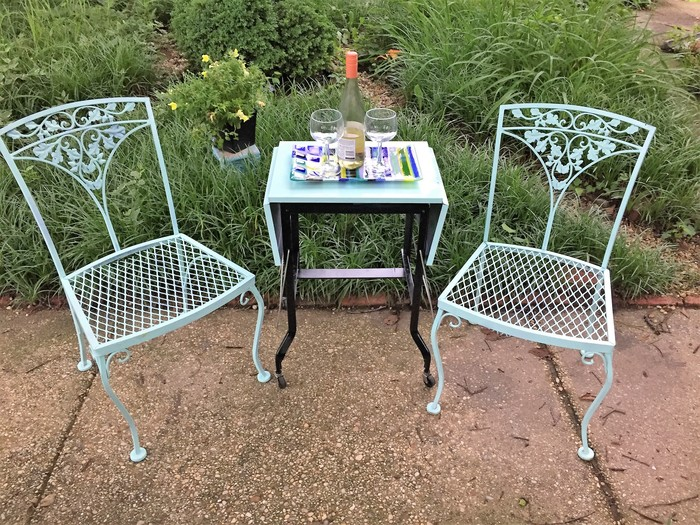 Tim's upcycled typewriter table used as an outdoor bistro table