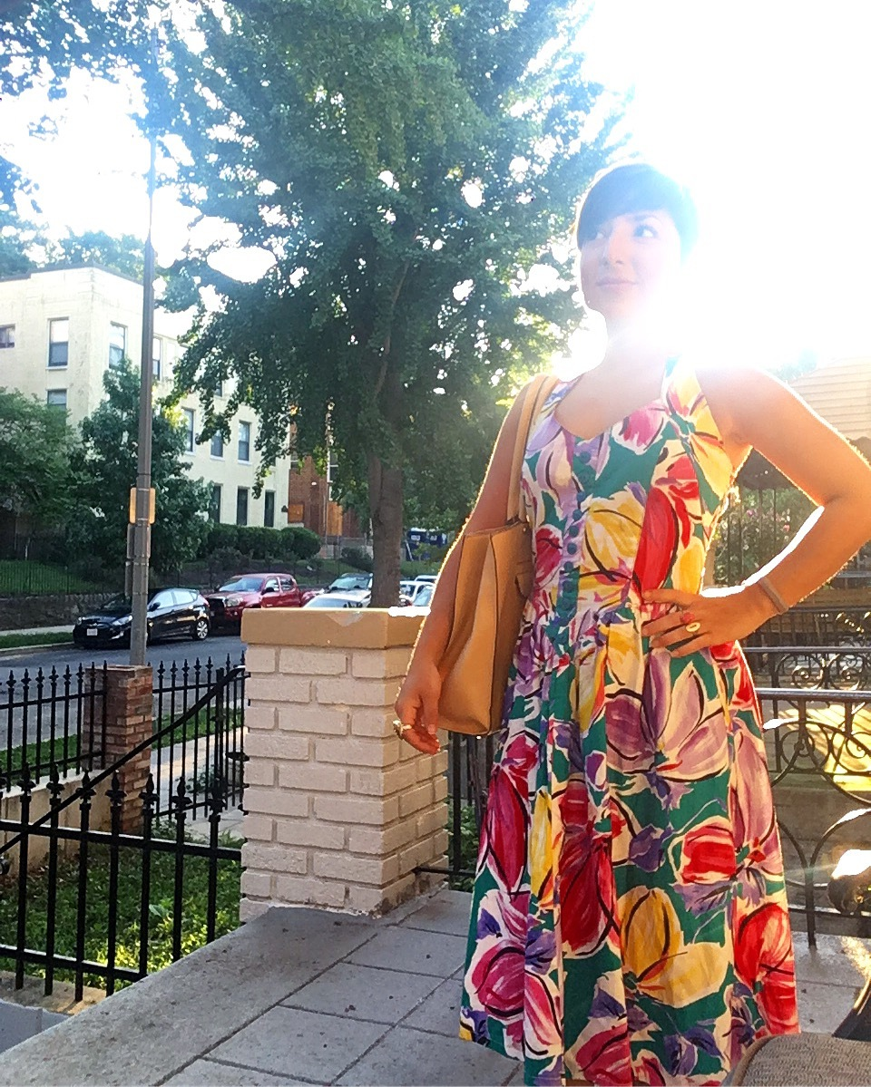 Carolyn poses in a colorful vintage dress