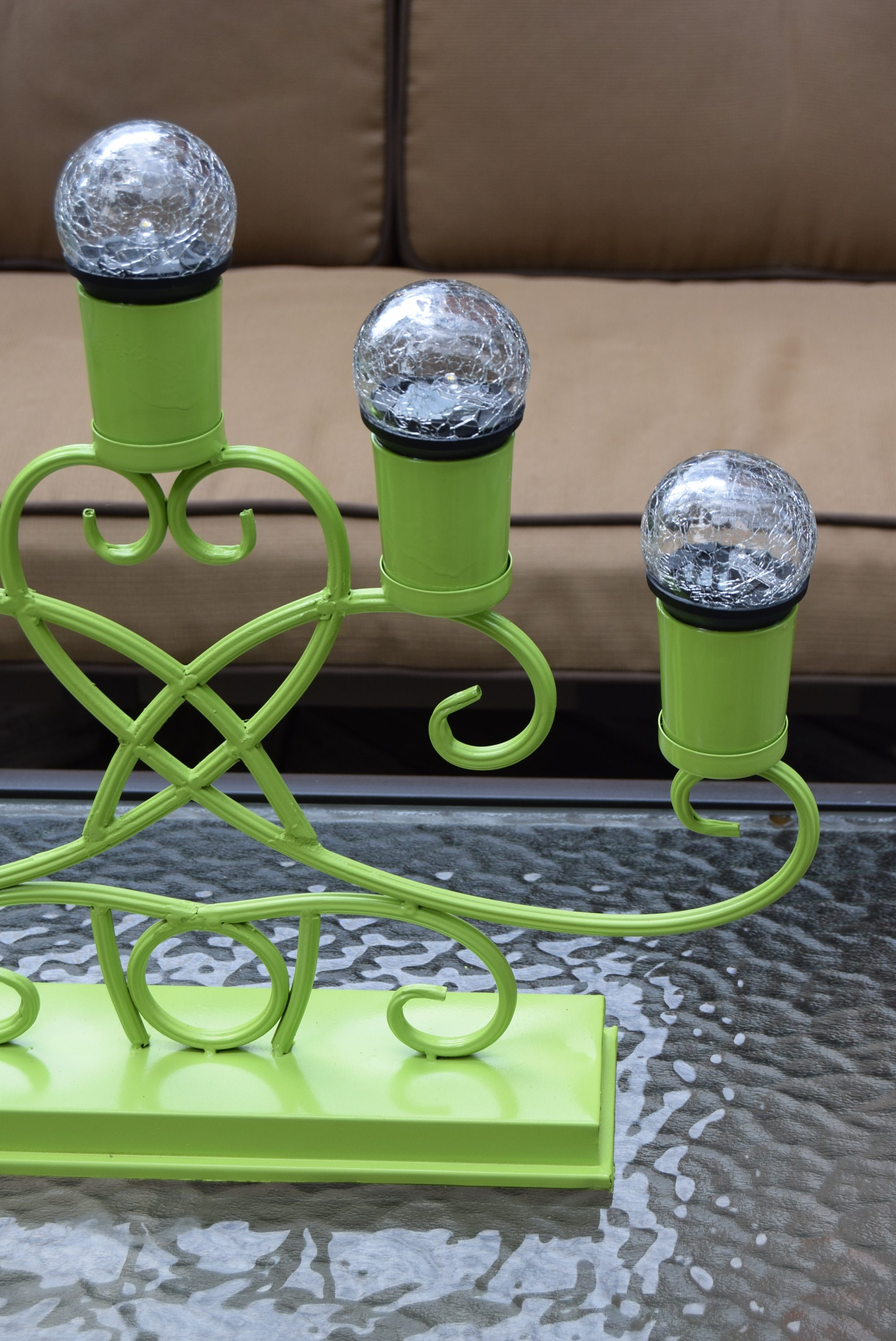 The painted candelabra after the solar lights have been added.