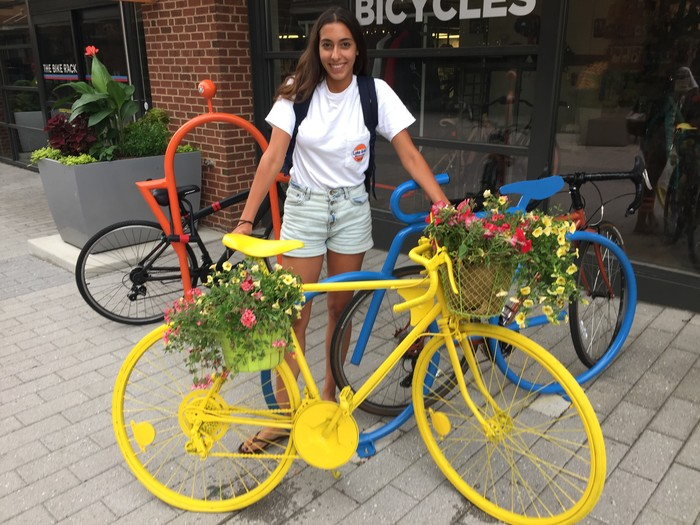 Tim's friend stands with completed bicycle planter