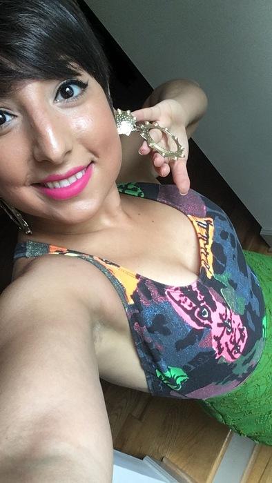 "Carolyn flaunts her vintage gold ""door knocker"" earrings"