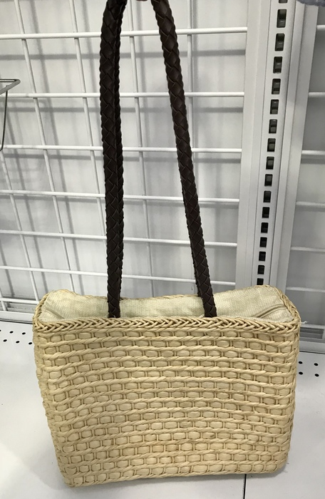 Straw bag with dark shoulder strap found at Goodwill in Bowie