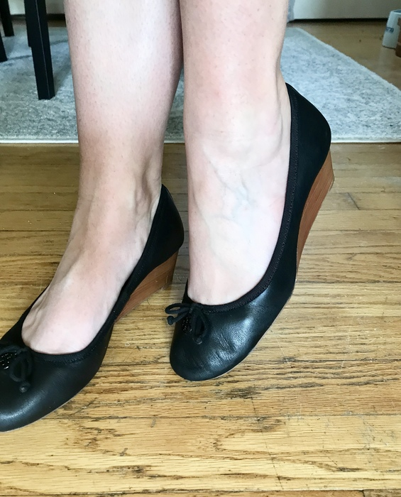 Karen wears her pair of Tory Burch wedges found at Goodwill