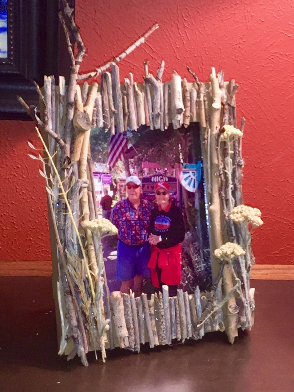 Tim displays a photo in his completed memento frame.