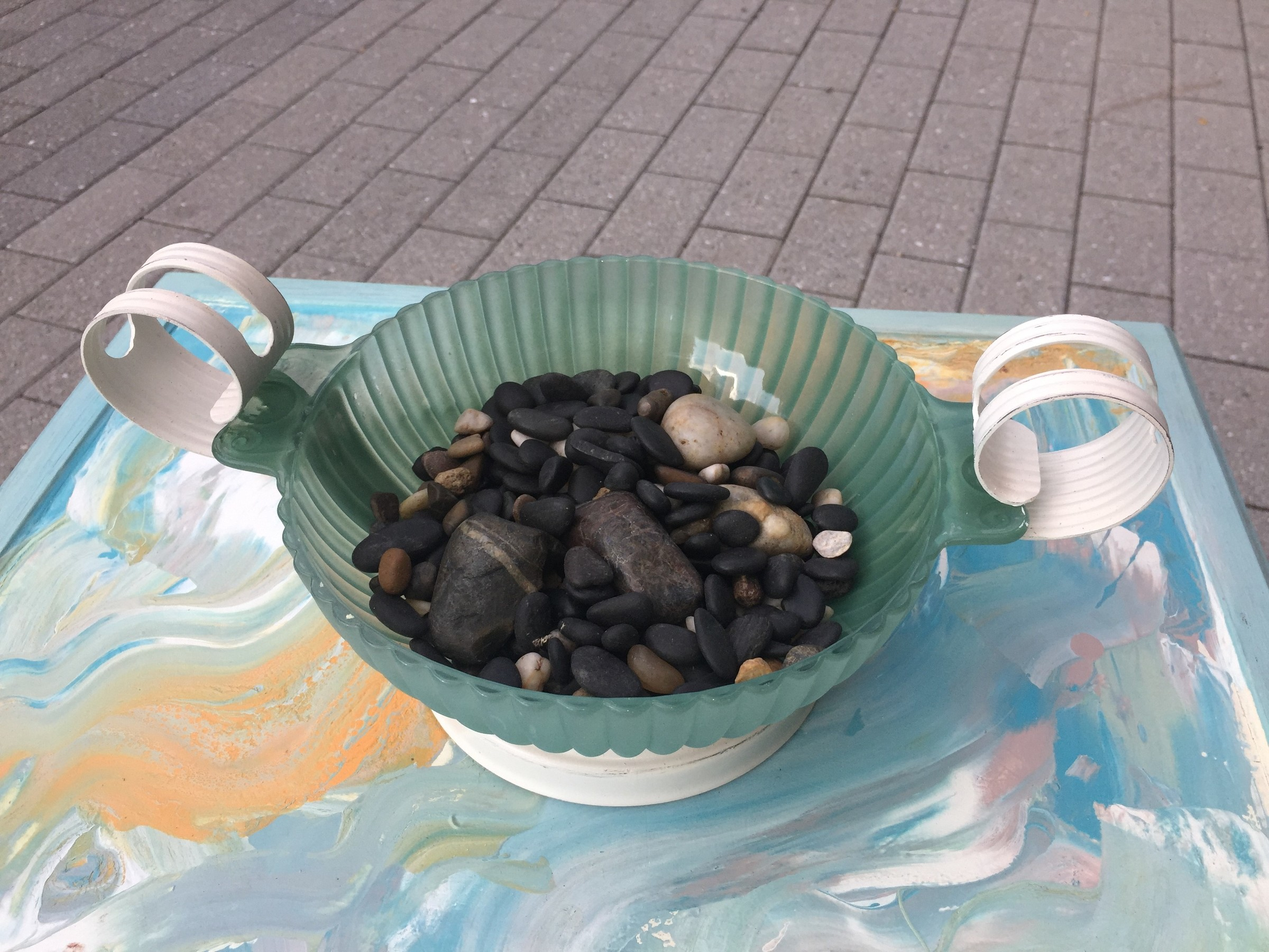 "Tim's ""beachy"" photo frame tray and painted sea glass bowl filled with pebbles."